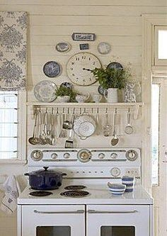 I love this because it conjures visions of a wide open country kitchen with a breeze blowing the lace curtains, a pie on the windowsill, a walk-in pantry that smells like spices, hot coffee in old worn cups and the ghosts of conversations past held around the hard-working kitchen table.