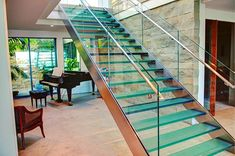 Our Ultimate Privacy #GlassFrit glass stair treads are featured in this beautiful home in Florida. #jockimo #glass #stairs #glassfrit #glasstreads #glassstairtreads #glassstairs #homedecor #instahome #instadecor #instadesign #instaglass #flashesofdelight #interiordesign #interiors #interiordesignideas #stairwell #interiordesigner #homestyling #hospitalitydesign #architecturaldesign #instahome #floridaglass #floridalife