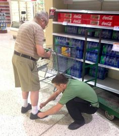 An employee at a Publix supermarket in Ormond Beach, Florida, lowering himself to the floor to tie the shoe of an elderly man who couldn't bend down.