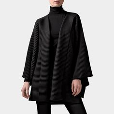 Fleece Jacket  A versatile wardrobe accessory, this warm black jacket is made of soft and luxurious pleated fleece, an award-winning fabric created by designer Marianne Abelsson. The Fleece Jacket is a classic modern design that drapes elegantly when worn and has a fold-over collar, wide sleeves, and side vents. Ideal for travel. Machine-wash. One size fits most.