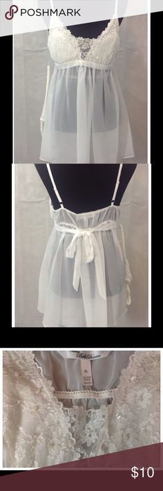 NWT Elegant Ivory 2 Piece Chemise Lovely, sheer, Ivory chemise with panties. A lovely gift for you or someone else. 100% polyester (exclusive of trim). Cold water wash. Intimates & Sleepwear Chemises & Slips