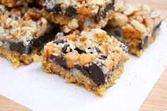 7 Layer Cookies ... you can't go wrong with 7 yummy ingredients layered together in a pan! www.thekitchenismyplayground.com