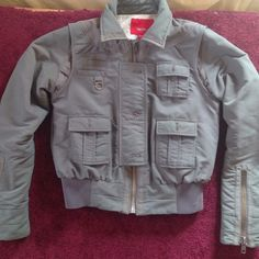 Army green jacket Adorable! Barely worn. In great shape. A bit of paint on the inside of the right cuff but not noticeable when worn Jackets & Coats