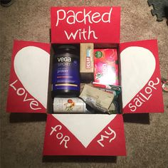 Valentine's care package. Decorate flaps for the box, the contents are just some thing he wanted. I don't think the insides have to be themed if you just want to send necessities anyways. The flaps are like an additional present!