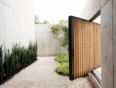 This Japanese Style Concrete Home is an inspirational example of Zen Architecture. Love the wood pivoting door which leads to the garden