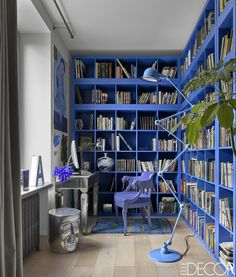 chose a vibrant blue color scheme for the library of his Moscow apartment. The bookshelves are by Ikea... by the way, this is too epic! Total DIY