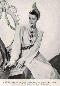 Wool housecoat/hostess dress with leopard belt and buttons by Lydia Moss, November 1938.