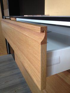 Handle is solid american oak. Draw front is Prime Panels Art Veneer Oak Planked