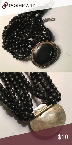 """Black bead necklace Multi stranded beaded necklace adjoins a large back and silver pendant (2""""). Jewelry Necklaces"""