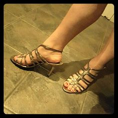 Nina Ricci Strappy Metallic Snakeskin Heels Nina Ricci brand. Size 11. Metallic rosegold silverish color.  Snakeskin print design. Strappy tops with ankle strap buckle.  Great condition. Super cute! Nina Ricci Shoes Heels