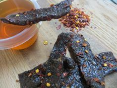 Sweet and Spicy beef jerky recipe with warm flavors of honey and crushed red pepper. This recipe is one of my absolute favorites!