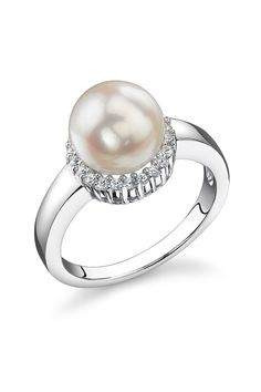 pearl ring surrounded in small diamonds. Silver band, non decorated. Simple, elegant, classic and sweet.
