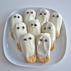 Ghost Cookies :) French Vanilla White Chocolate Covered Cookie Ghosts with Chocolate Chip Eyes: Boo! Did I scare you? I certainly hope not, because this delicious treat is definitely not scary - in fact the only scary thing is NOT ordering these cute ghosts!    Vienna finger cookies are hand dipped in Belgian white chocolate and then decorated with two mini chocolate chips for the eyes.