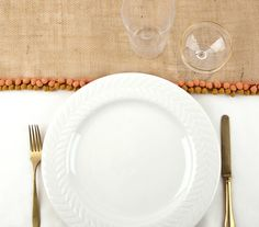 Dress up your Thanksgiving table with one of these easy DIY runners. Pair it with a plain tablecloth and a simple centerpiece—your table will be all set for a festive (and delicious) feast.