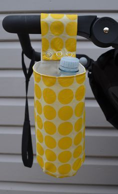 Pram drink bottle holder, cute yellow dots. White flower laminated cotton inner, 100% cotton outer. Keep your water handy when you're out and about!