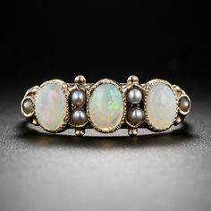 Victorian Opal and Pearl Ring. A trio of opals imbued with pastel colored palettes alternate with tiny lustrous seed pearls in this very sweet Victorian treat