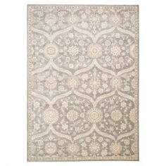 Add a touch of style to your living room or home library floors with this wool and art silk rug, featuring a Persian-inspired motif in a neutral palette.  Product: RugConstruction Material: Wool and art silkColor: Ironstone Note: Please be aware that actual colors may vary from those shown on your screen. Accent rugs may also not show the entire pattern that the corresponding area rugs have.