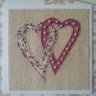 A gorgeous card. made up of 2 lovely hearts. one flowery. one plain decorated with little pink beads. Card size 100mm x 100mm. Card comes with envelope and cello bag. Card is blank for own message Each card may very slighty.