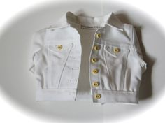 White jean jacket by RainbowLilyDesigns on Etsy. Made with the LJC Denim Jacket pattern, found at http://www.pixiefaire.com/products/denim-jacket-18-doll-clothes. #pixiefaire #libertyjane #denimjacket