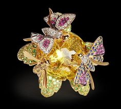 Butterfly Ring Butterfly ring with diamonds, tsavorites, rubies, sapphires and crystal set in 18k yellow gold.