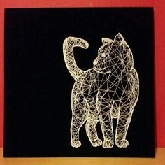 Handmade cat string art with black baize background and white string
