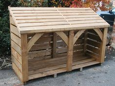 long 4 ft high Log Store, delivered fully constructed This is in Blackfriars light brown and takes a cubic mtr of logs. Outdoor Firewood Rack, Firewood Shed, Firewood Storage, Outdoor Storage, Lumber Storage Rack, Wood Storage Sheds, Tool Storage, Log Shed, Bike Shed