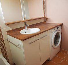 Gagnez de l'espace dans votre salle de bain, en encastrant le lave-linge sous le plan de toilette de votre meuble !