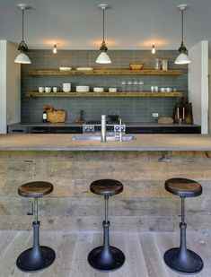 Rustic modern kitchen, great idea for wood planked bar front because it will only look more interesting with wear. I like the way that rustic wood is repeated in the shelving - Bates Masi Architects