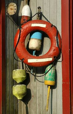 Maine -- old time wooden life saver & lobster trap floating buoys