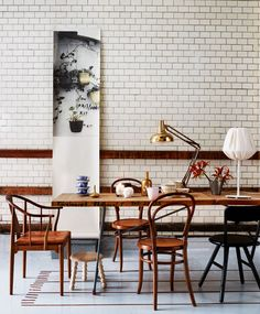 tiled wall, mismatched wood chairs