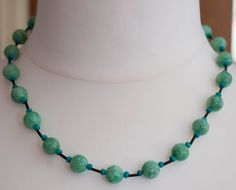 Stunning green jade necklace with complimenting beads.