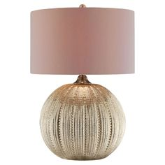 An eye-catching addition to your reading nook or bedside, this stylish table lamp showcases a textured orb-shaped base and classic drum shade.