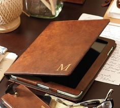 Pottery Barn - Saddle Leather iPad2 Case   fine saddle leather with monogramming. retails for $69.50