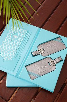 The couple invite their guests to this destination wedding with a set of personalized luggage tags.