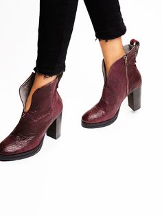 Bolo Bandit Ankle Boot   Soft leather ankle boots featuring a deep-V in front and a high stacked block heel. Pull tab in back and an exposed side zip closure for an easy on-off.
