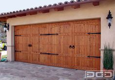 Handcrafted in Cedar Wood. Lightly stained and finished in a satin clear coat Custom Garage Door.