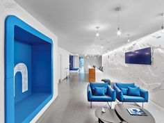 LinkedIn Toronto HQ Office, Canada. In reception, chairs by Sam Hecht and Kim Colin gather near a wall-size topographical map of Canada in CNC-cut, painted MDF. #office large social media company