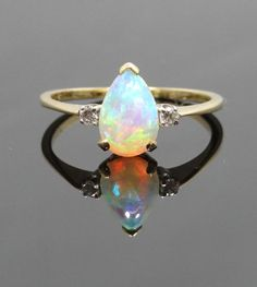 Amazing 14K Yellow Gold and Pear Shaped Opal Ring - RGOP102P. $565.00, via Etsy.-- Mom, if I could I would get this ring for you.