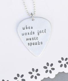 Hand Stamped Guitar pick - when words fail music speaks - custom font. $18.00, via Etsy.