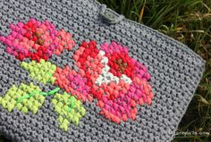 Why use one craft, when you can combine two crafts into one project. Cross stitch on crochet have been showing up more and more in our timeline recently
