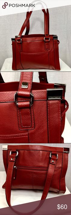 TIGNANELLO Red Leather Shoulder Bag This red leather shoulder bag is in excellent condition. It has been very gently loved.  There are no flaws or spots on it. If you are someone who likes a lot of sections, this is for you! It has three main sections inside and several other pockets. Tignanello Bags Shoulder Bags