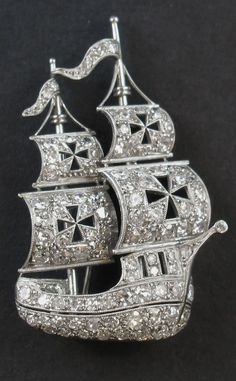 A platinum and diamond Caravel brooch, circa 1930. #brooch #DiamondBrooches #VintageJewelry