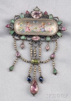 Antique Silver, Enamel, and Gem-set Pendant/Brooch, the polychrome enamel scene depicting winged putti at play, in an elaborate frame suspending drops set with various colored stones and split pearls, 2 3/8 x 3 1/2 in.  Estimate $400-600 ~  Skinner