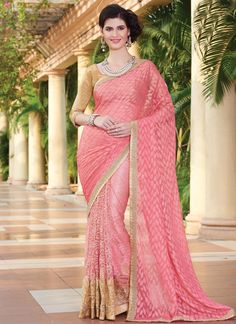 An outstanding pink net and faux chiffon designer saree will make you look extremely stylish and graceful. The interesting embroidered and patch border work in the course of the dress is awe inspiring...