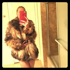 Additional pictures. Genuine raccoon fur coat I have been asked to post more pictures, please note - I am a size small, even though the coat is a L, it looks little bulky on me, it would fit perfect medium and large. Also, if you are in love with the little baggy fit being Small size, this is exactly how it will fit! Super sexy just to throw on a cocktail dress Wilsons Leather Jackets & Coats