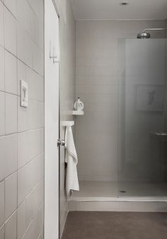 White tiles and glass shower door in the bathroom   | Usual House
