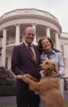 Gerald Ford, his wife Betty and their dog Liberty posing in front of the White House