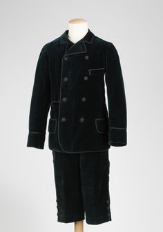 This particular suit was designed by Brokaw Bros. of New York circa 1890 for a boy between the ages of 10 and 14. At the turn of the century boys usually transitioned to long trousers around age 15 or so.