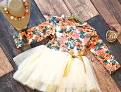 Up to 76% off retail!  Our Outfit of the Month continues with this darling tutu dress!  It features a beautiful fall floral print, fluffy tutu skirt and satin ribbon bow.  It's the perfect dress to take your little lady through into the Fall season! Complete the look by adding on the coordinating necklace for just $7.00 ($25 retail value)! Available Sizes (we recommend you order up if closer to the end of a size): 0-6 months 6-12 months 12-18 months 2T 3T 4T 5 6/6X 7/8 10/12 Best Price…