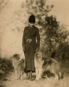 Beautiful Charles Gates Sheldon fashion portrait of a model and her collies